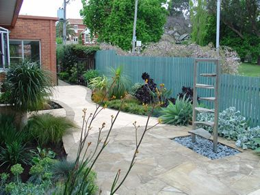 Hawthorn Residential Garden:  A custom designed water feature creates a strong focal point in this young waterwise garden.