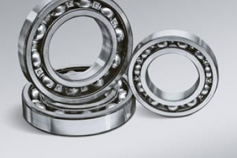 Bearings are used to reduce friction at the interface of parts which move in relation to one another.  There are many different types of bearings a bushing is simply a sleeve which is pressed into a hole.  A shaft rides inside this sleeve.  Bushings are typically used in low speed applications where friction is not a primary concern. http://www.hrbearings.net/ball-bearings.html