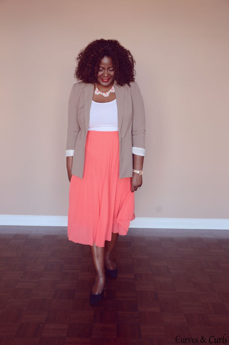 Plus size fashion for women: how to wear a pleated coral skirt. #spring #outfit #inspiration