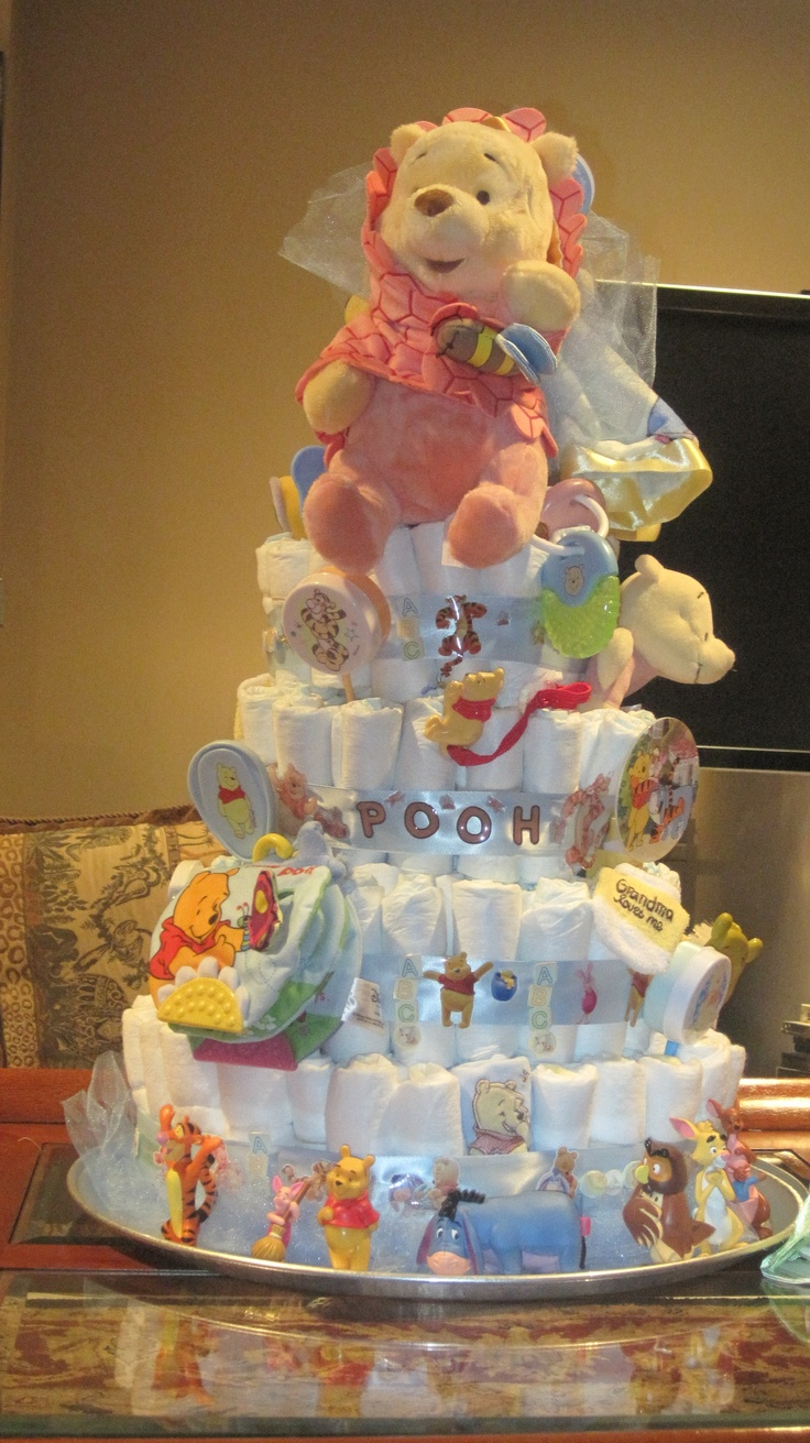 I need to make a ba diaper cake like this for my new little cousin!  She'll be here in June. :)
