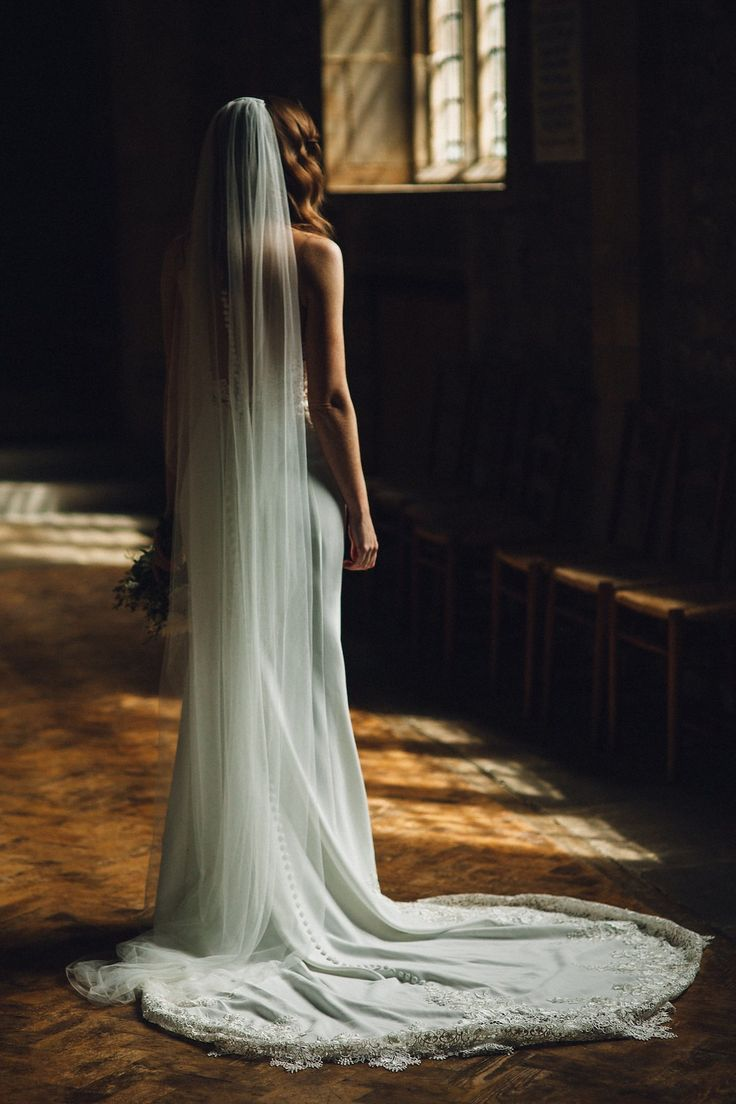 Caroline wore a Martina Liana gown for her elegant rainy day barn wedding. Images captured by Red On Blonde Photography.