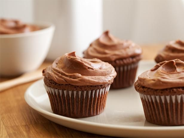 Double-Feature Cupcakes with Mexican Hot Chocolate Frosting : Chocolate cupcakes are topped with a cream cheese and chocolate frosting for a decadent hand-held treat.