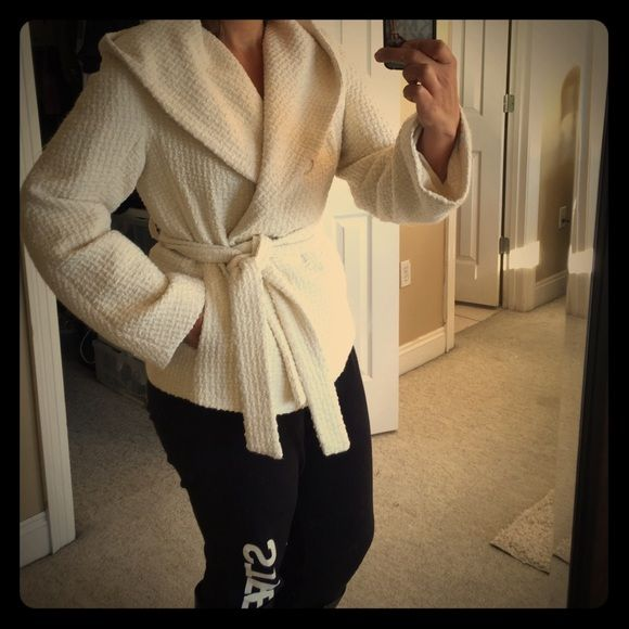 BCBGMaxazria coat Beautiful BCBGMAXAZRIA Winter white short coat with a hoodie great detail very warm I wore this coat  only one time it looks great with anything you wear it with BCBGMaxAzria Jackets & Coats