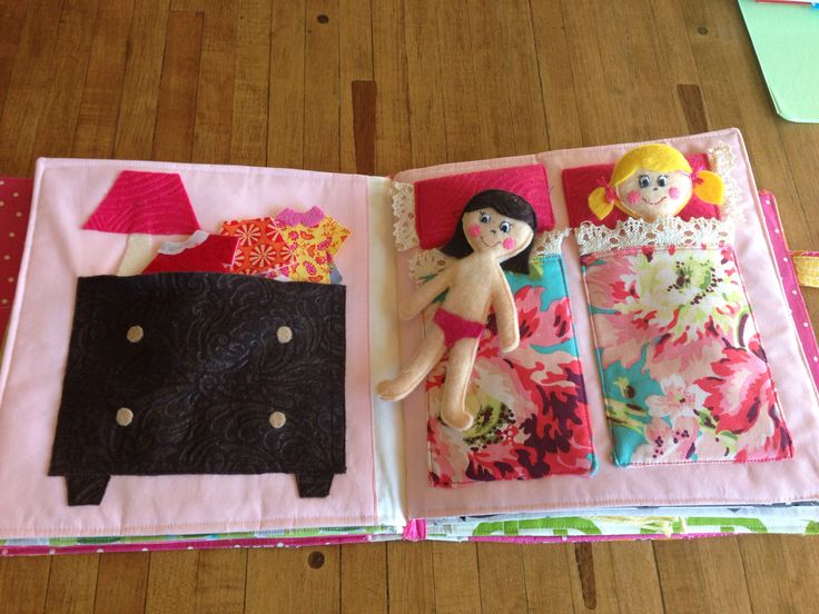 Quiet book page.  Dressing.  Felt dolls tucked in their beds.  Felt clothes in the dresser.