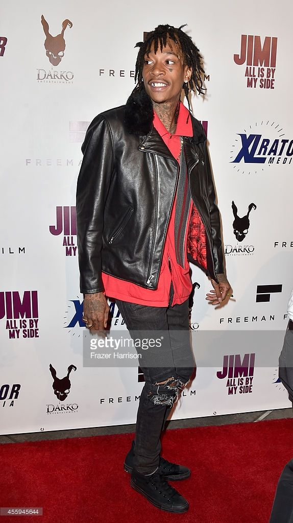 Rapper Wiz Khalifa arrives at the Screening Of 'Jimi: All Is By My Side' at ArcLight Cinemas on September 22, 2014 in Hollywood, California.