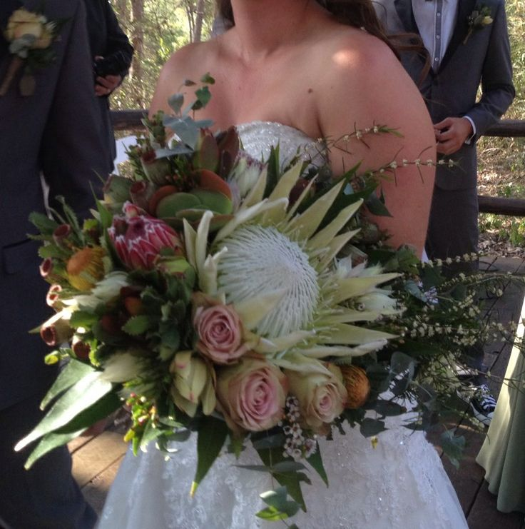 The Bride! King protea and mix of natives with a couple of antique pink roses.