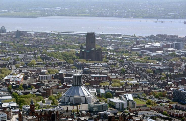 Get a bird's eye view of Merseyside's famous landmarks including the docklands and Liverpool FC's stadium expansion