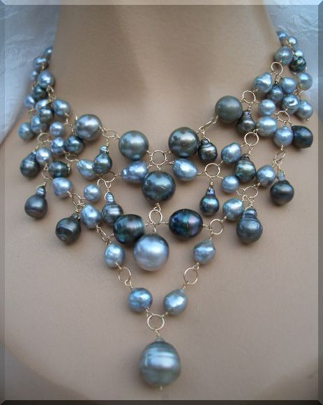 """16"""" 14kt white gold Tahitian pearl station necklace adorned by 4 lovely round, natural color Tahitian pearls(9.5mm) and finished by a diamond centerpiece (.60ct/tw SI1-GH) suspending an equally beautiful 11mm Tahitian pearl."""