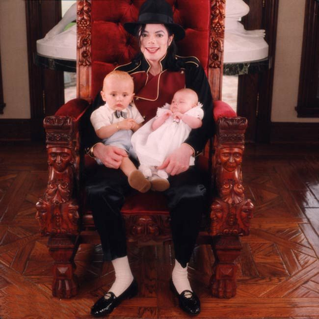 Michael Jackson with son Prince (age 1) and baby daughter Paris in 1998 at their home Neverland