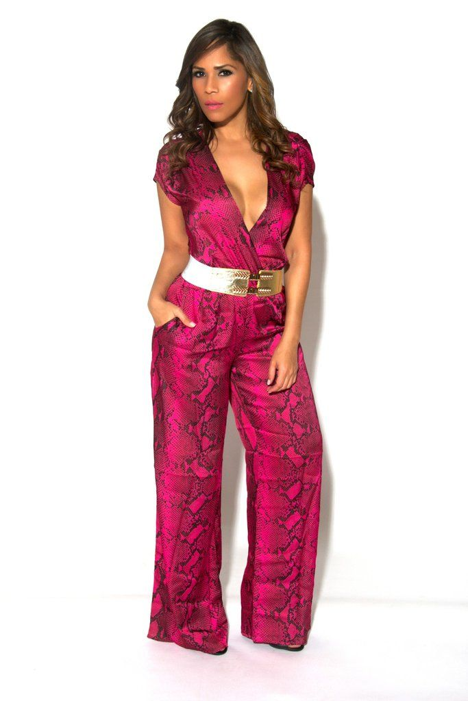 All eyes will be on you when you walk into the party sporting this fun, stylish one-piece. Smooth, stretchy, wide-leg palazzo jumpsuit features a modified snake print, a plunging neckline, and finished with an elasticized empire waist. No closures are included. Belt not included.