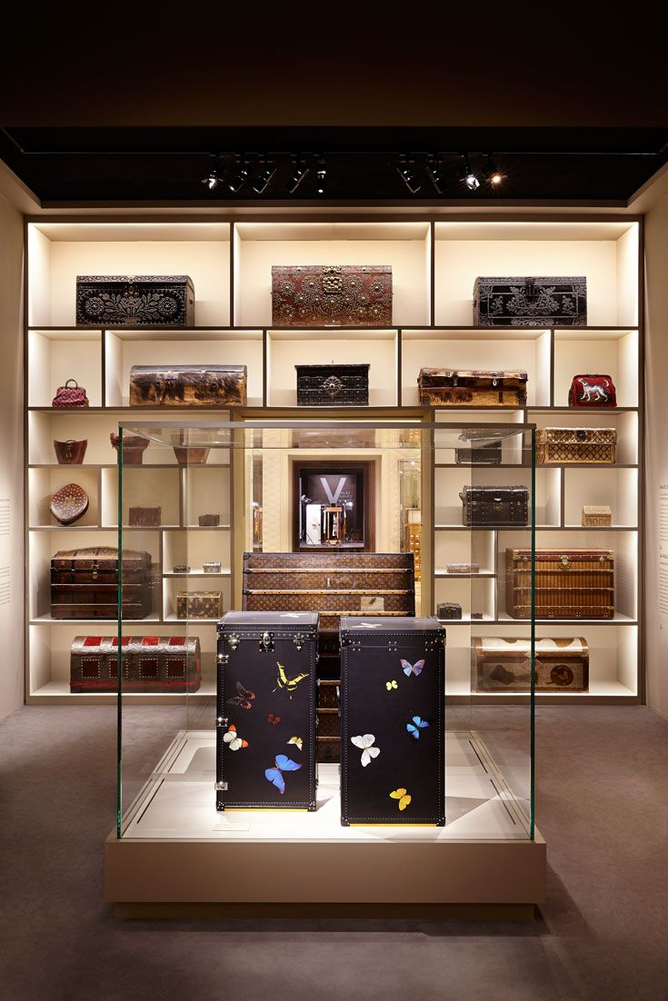 """On display in the """"Volez, Voguez, Voyagez - Louis Vuitton"""" exhibition at the Grand Palais in Paris, these twin trunks were crafted in partnership with Damien Hirst for the 150th Anniversary of the Red Cross."""