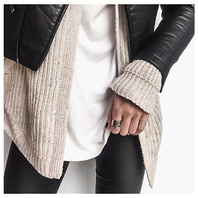 Leather jacket layered with sweater