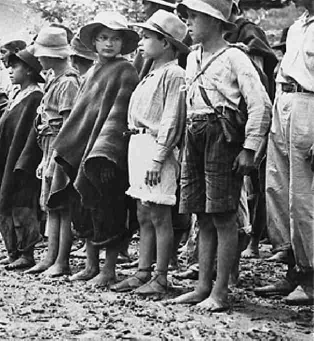 A Group Of Colombian Children Involved As Soldiers During