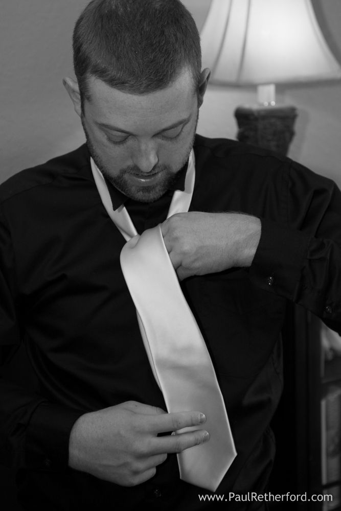 Groom putting on tie Bear Lake Reserve Wedding Photography North Carolina Smoky Mountain Wedding Venue Jamie + Jason photo by Paul Retherford #BearLakeReserve #DestinationVenue #Wedding #SmokyMountain