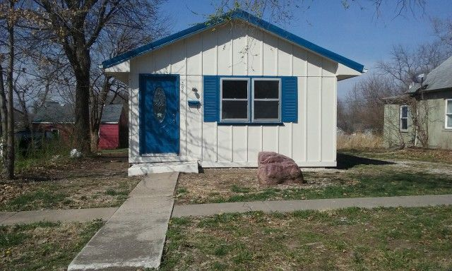 This cozy home is a perfect starter home for a couple or home for a single person. All new carpet and vinyl throughout. Kitchen counter tops are new and so is the metal roof. Very large shop in back for vehicle, storage, and projects; has access from driveway and alley in Higginsville MO