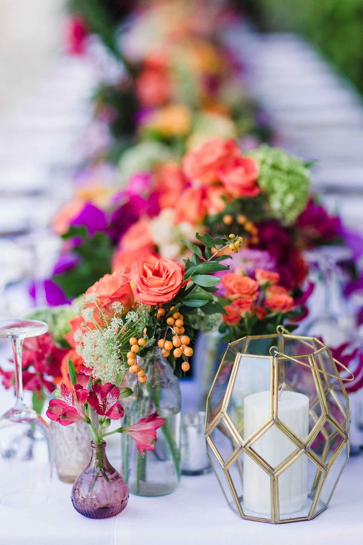 colorful tablescapes - photo by Imaj Gallery http://ruffledblog.com/vibrant-bali-wedding-with-a-hanging-botanical-installation