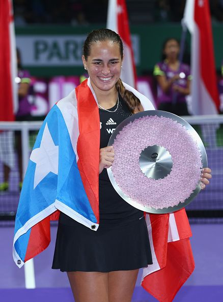 10/21/14 Monica Puig of Puerto Rico holds the Winners Trophy and her Nat'l flag after her two set victory v Saisai Zheng of China in the Inaugural WTA Rising Stars FINAL held at the year-end #WTAFinals Singapore. Monica is a perfect 3-0 at her 1st year-end WTA FINALS.