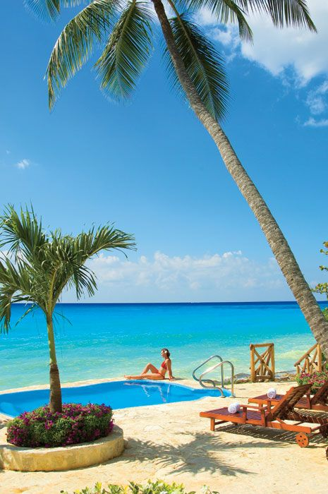The outdoor Spa area at Dreams La Romana offers breathtaking views of the ocean and sandy-white beach.
