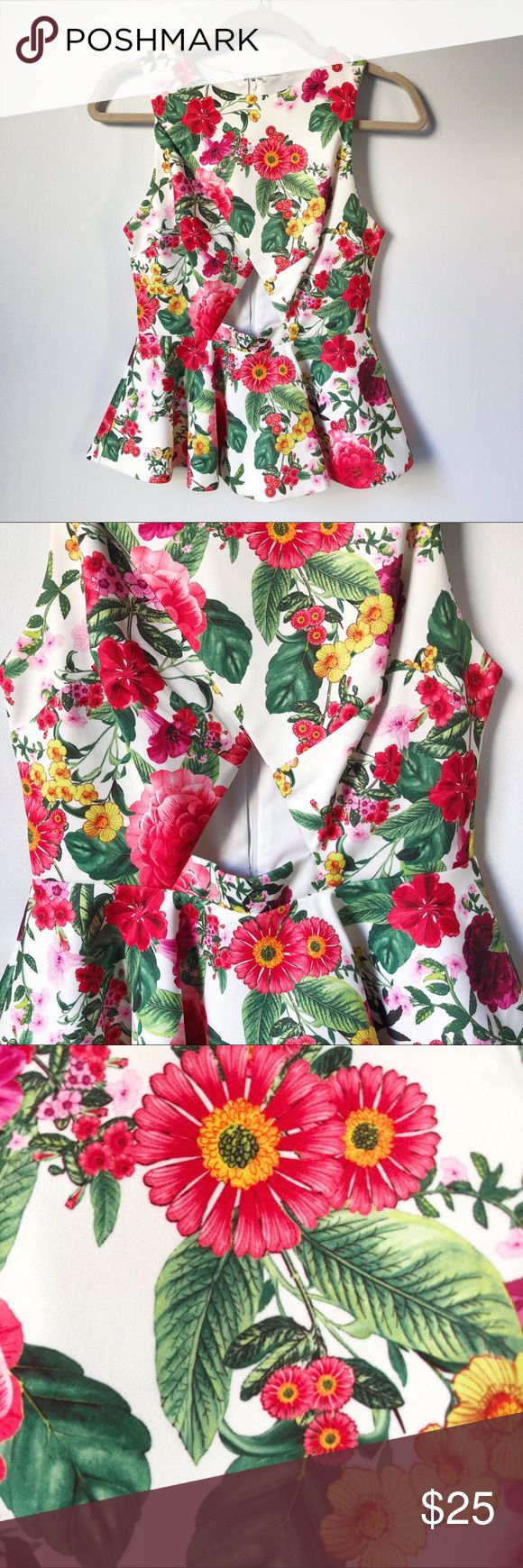 ASOS Red Floral Peek-A-Boo Cut Out Peplum Top This fun peplum features red florals, hints of yellow, pink and green, and a cutout that takes the look from ordinary to extraordinary. Great for spring and summer!   20.5 inches long  ***Buy with matching bottom for the complete look*** Bundle deal on any 3 items when you shop from my closet. ASOS Tops Blouses