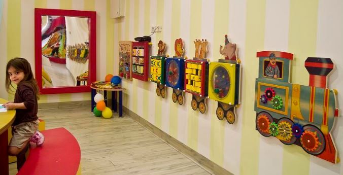 Not every waiting room has enough space for a lot of toys. That's another reason why wall-mounted toys are so wonderful for any waiting room. They are not only a more efficient way to use space, but they also allow multiple kids to play with the toy at the same time. These wall toys and many more at: www.sensoryedge.com photo by: s3.amazonaws.com