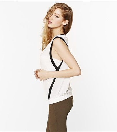 We're currently obsessed with this sleeveless top features a trendy mesh trim.