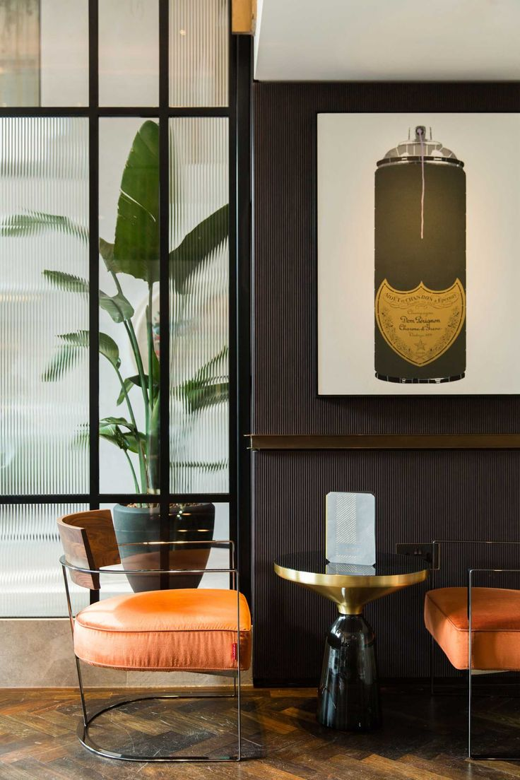 mid century chairs. Athenaeum Hotel & Residences by Kinnersley Kent Design.