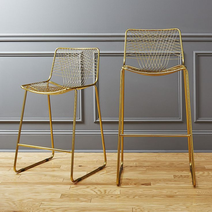 Shop alpha brass bar stools.   Warm brass lacquers a handmade iron frame with woven wire back.  Expertly welded into a graphic linear pattern, thoughtful design details stun from any angle.