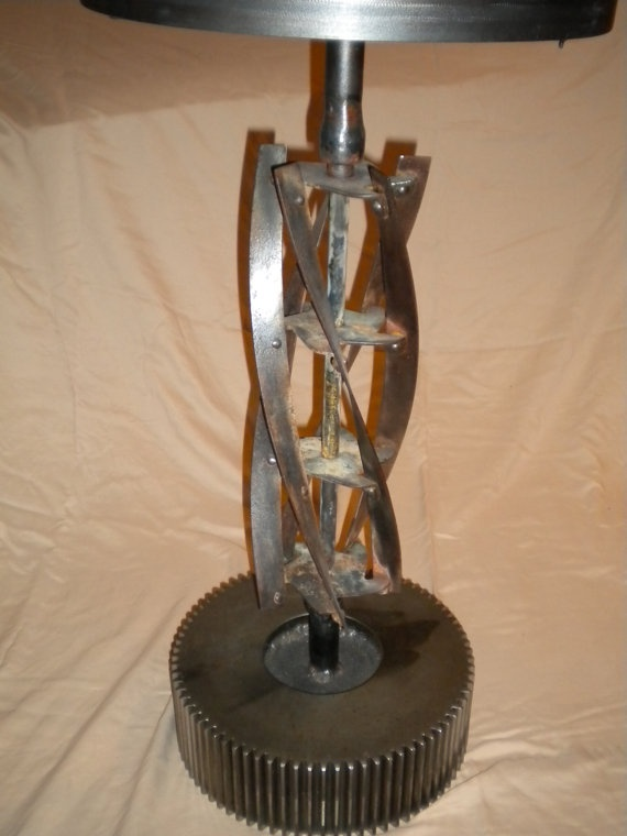 an old rotary mower blade could be turned into a lamp