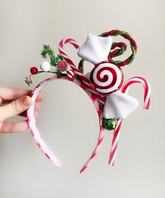 A fabulous holiday headband featuring candy canes, a peppermint candy hair bow, and glittery licorice spirals! Youre an instant holiday cutie with glitter on top, in this headband. The base is made of wrapped satin, and is lightweight and comfortable to wear. MADE TO ORDER, ships in