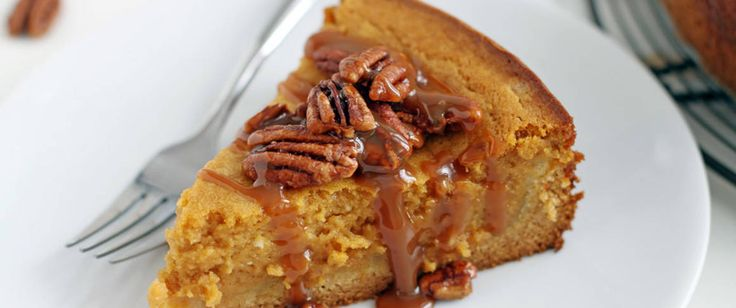 An over-the-top gooey pumpkin cake with caramel sauce and candied pecans.