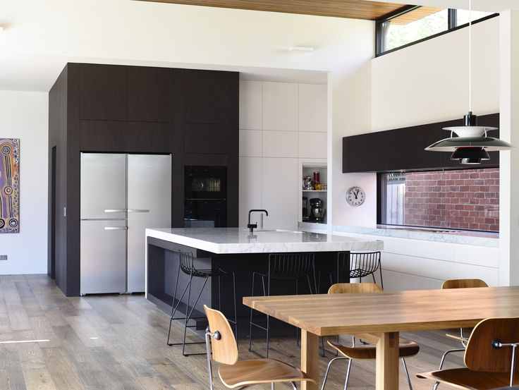 Kitchen and dining space. Louis Poulson PH50 in Olive black, Vola KV1 tap in matt black and Massproductions Tio stools
