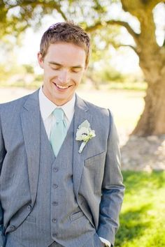 A light aqua green is a perfect color for any destination wedding. This groom looks so handsome with his gorgeous tie!