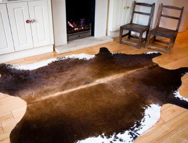 cowhide rug  Size 2.5m x 2.2m   Price £ 220