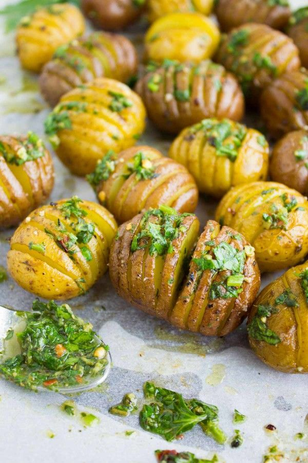 Absolutely the best herb roast potatoes recipe! Hasselback and roasted till crispy on the outside and tender on the inside, then brushed with herb butter.