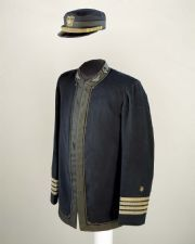 Captain Charles Gridley's Coat & Cap: An Annapolis graduate, Captain Charles Gridley was commander of the USS Olympia, the flagship of Commodore George Dewey's Asiatic Squadron at the Battle of Manila Bay. Dewey, in command of the overall squadron, was also aboard Olympia at the beginning of the battle.