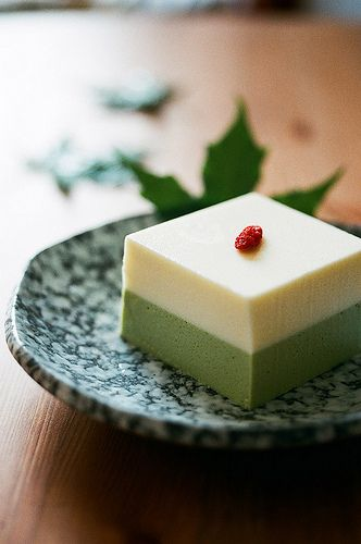 Matcha cheesecake with a Chinese wolfberry fruit for garnish