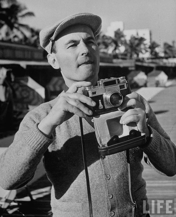 German tenor and movie actor Jan Kiepura holding his Contax camera as he hones in on a possible photo during his vacation . Miami Beach . February 1940 . Photo by Alfred Eisenstaedt