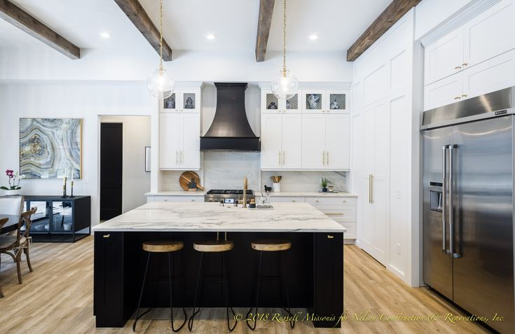 Gorgeous black and white kitchen with brass fixtures for this home remodel and home addition we did in Brandon, Florida.