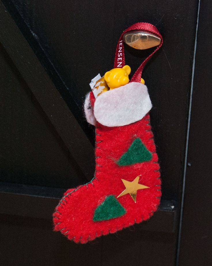 Miniature Christmas stocking for our miniature door for the house alf/pixie/julenisse. Gimmick for kids in Scandinavia. See more at www.evabyeva.dk