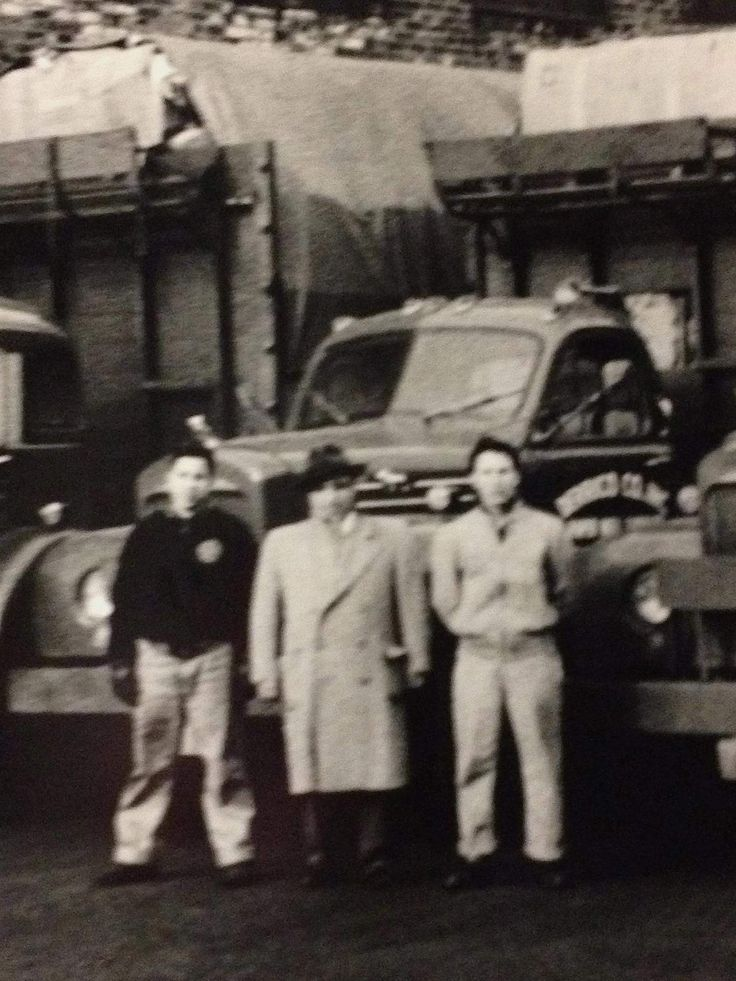 My grandfather after his recycling company bought it's first truck! 1930 (?)