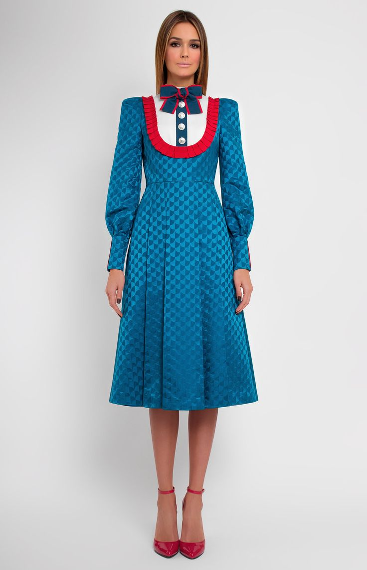 Slim-fit long-sleeve dress decorated with cotton ribbon. Designer handmade bow. Band collar. Hidden back zip closure. Without pockets.