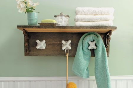 I would love to add this cottage/beachy style shelf to my bathroom as well. I love the hooks, I think thats my favorite part of this decor!
