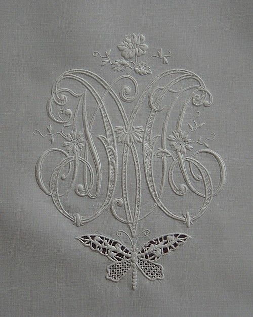 This is a very pretty monogram!  Love how it is intertwined wished the letters were a little easier to read however!
