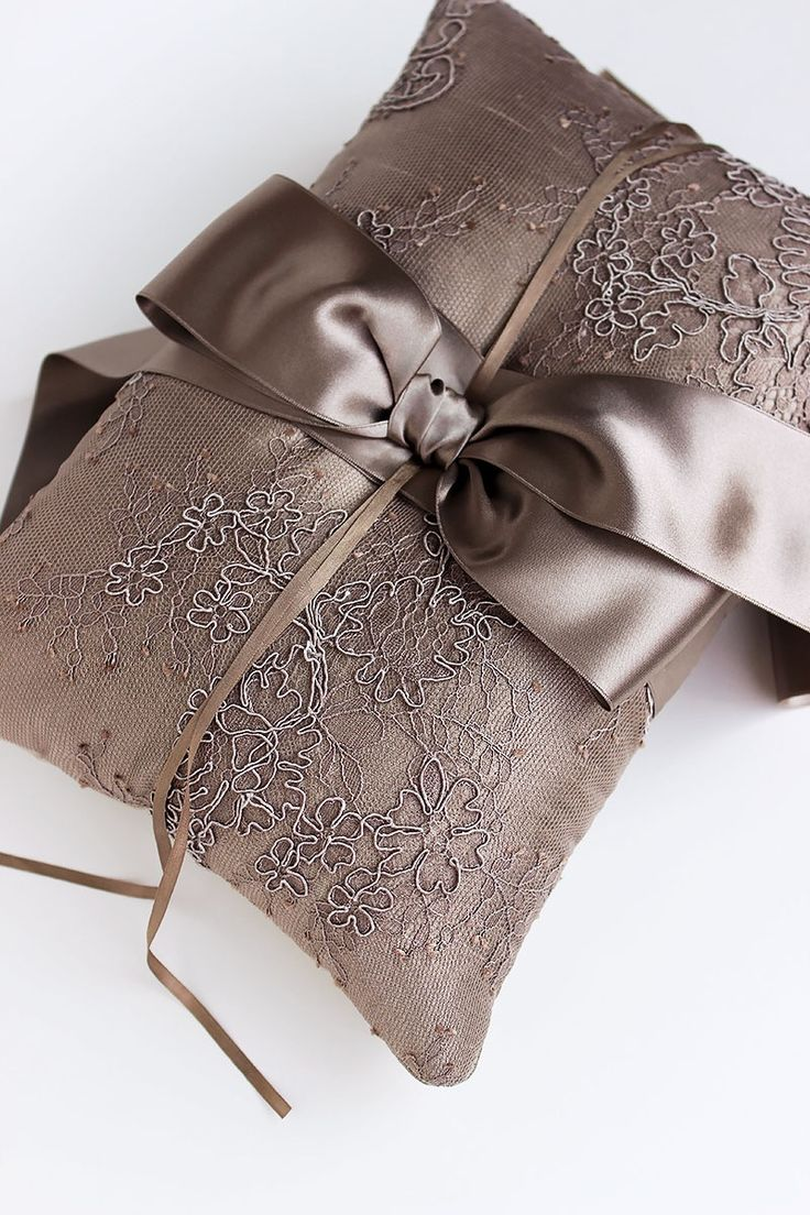 Beautiful taupe French lace overlay on this silk ring bearer pillow. French lace layered over taupe dupioni silk. Paired with super soft taupe...