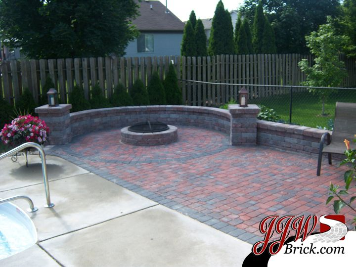 Brick patio design with fire pit and seating walls for Backyard brick fire pit