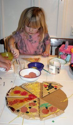 Cardboard Pizza Craft - Maybe add in a game spinner to see what goes on each slice & read Pete's a Pizza together with the activity.
