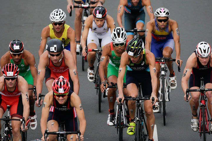 Brazil's Reinaldo Colucci, center, is followed by Mexico's Irving Perez as they ride in the middle of a pack during the Men's Triathlon at the Pan Am Games in Toronto, Ontario, Sunday, July 12, 2015. (Photo:AP Photo/Felipe Dana)