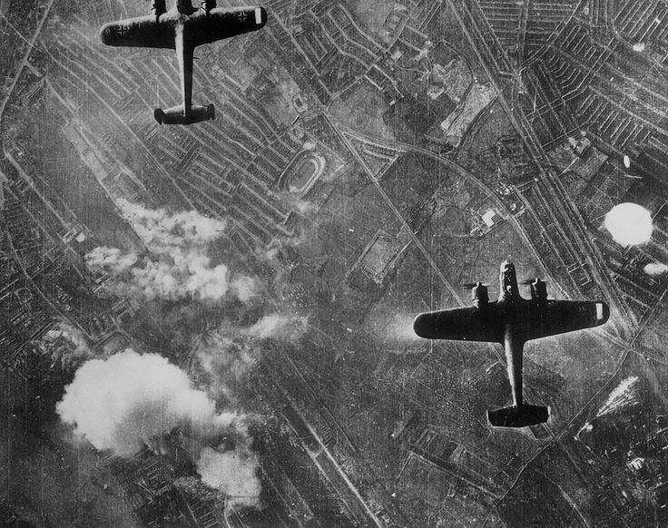 London Blitz: two Dornier 217's flying over the Silvertown area of London's Docklands. Fires have started near the Beckton Gasworks. West Ham greyhound track is near the centre of the picture, which was taken from a German bomber.