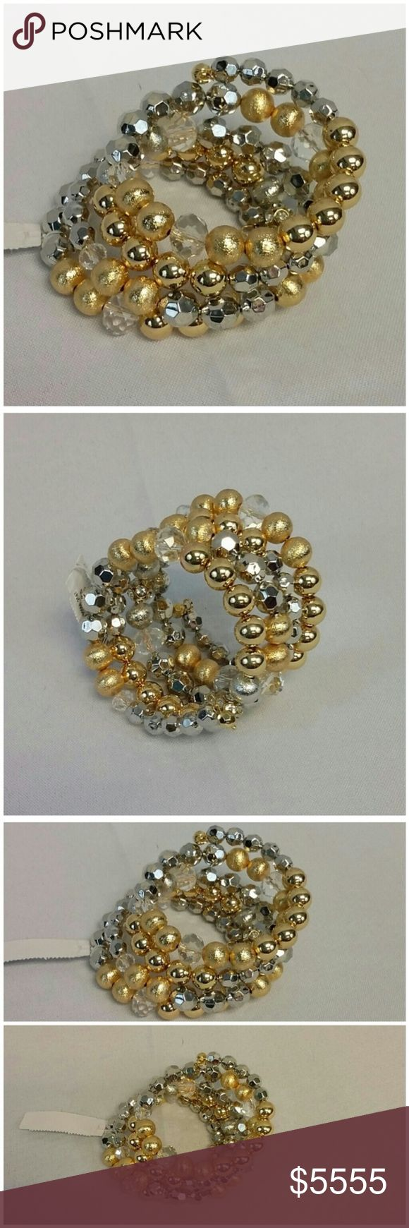 Offers of 40% Less on BUNDLES Always Accepted! Gold/Silver-tone Varying Size Round Balls Bracelet, gold-tone, silver-tone, crystal, clear, and prizm balls in varying sizes and finish, wraps around wrist multiple times, stretchy, one size fits most, New With Tag, in bubble wrap and plastic. ADD to a BUNDLE! Offers of 40% Less on BUNDLES Always Accepted! New York & Company Jewelry Bracelets