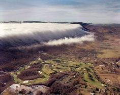This is a photograph of the fog rolling over East River Mountain to Bluefield, West Virginia. It Features the Fincastle Country Club and golf course. It was photographed on the same day as Fog Over East River Mountain.